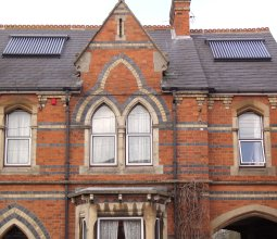 two solar panels installed on a period house roof